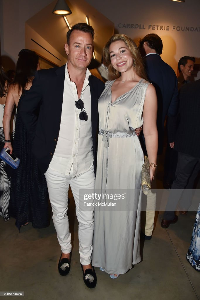 Chris Leavitt and Tierney Model attend the Midsummer Party 2017 at Parrish Art Museum on July 15, 2017 in Water Mill, New York.