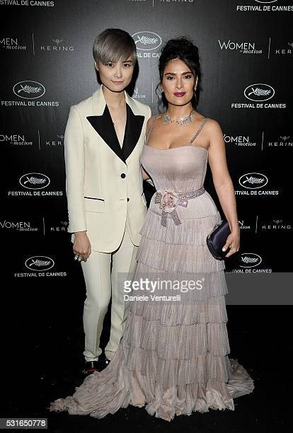 Chris Lee and Salma Hayek Pinault attend the Kering And Cannes Film Festival Official Dinner at Place de la Castre on May 15 2016 in Cannes France