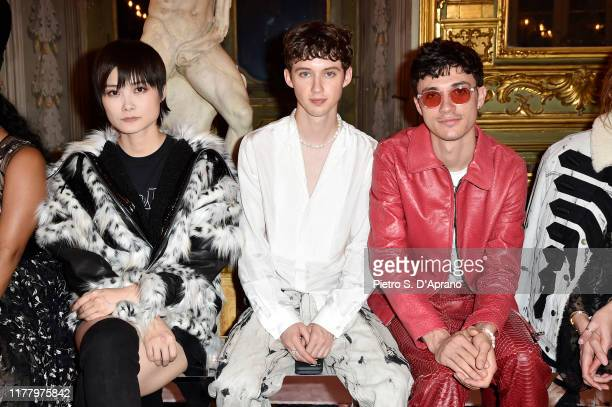 Chris Lee Troye Sivan and Jacob Bixenman attend the 'Giambattista Valli Loves HM' Show on October 24 2019 in Rome Italy