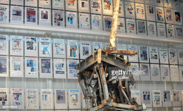 Chris LEFKOW The mangled tv antenna from the World Trade Center anchors the 9/11 exhibit with a wall of that days front pages from around the world...