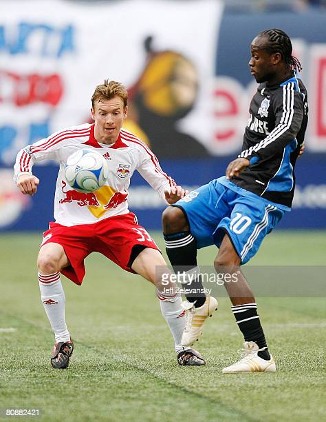 Chris Leitch of the New York Red Bulls and Peguero Jean Phillipe of the San Jose Earthquakes battle for the ball at Giants Stadium in the Meadowlands...