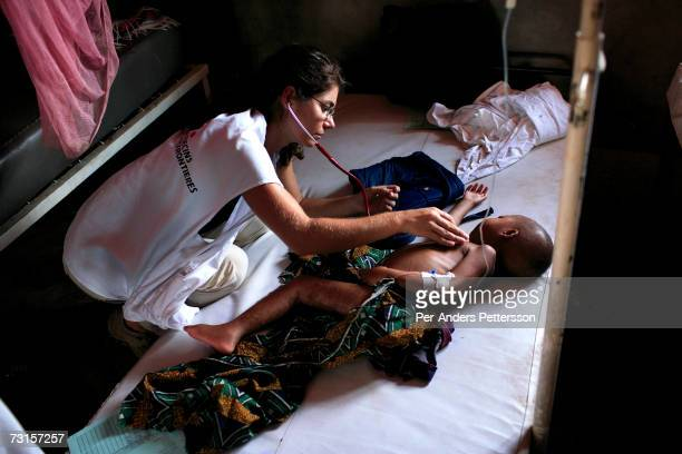 Chris Lenzen, a German medical doctor, checks on a sick patient on December 10, 2005 in Dubie, Katanga Province in Congo, Democratic Republic of the...