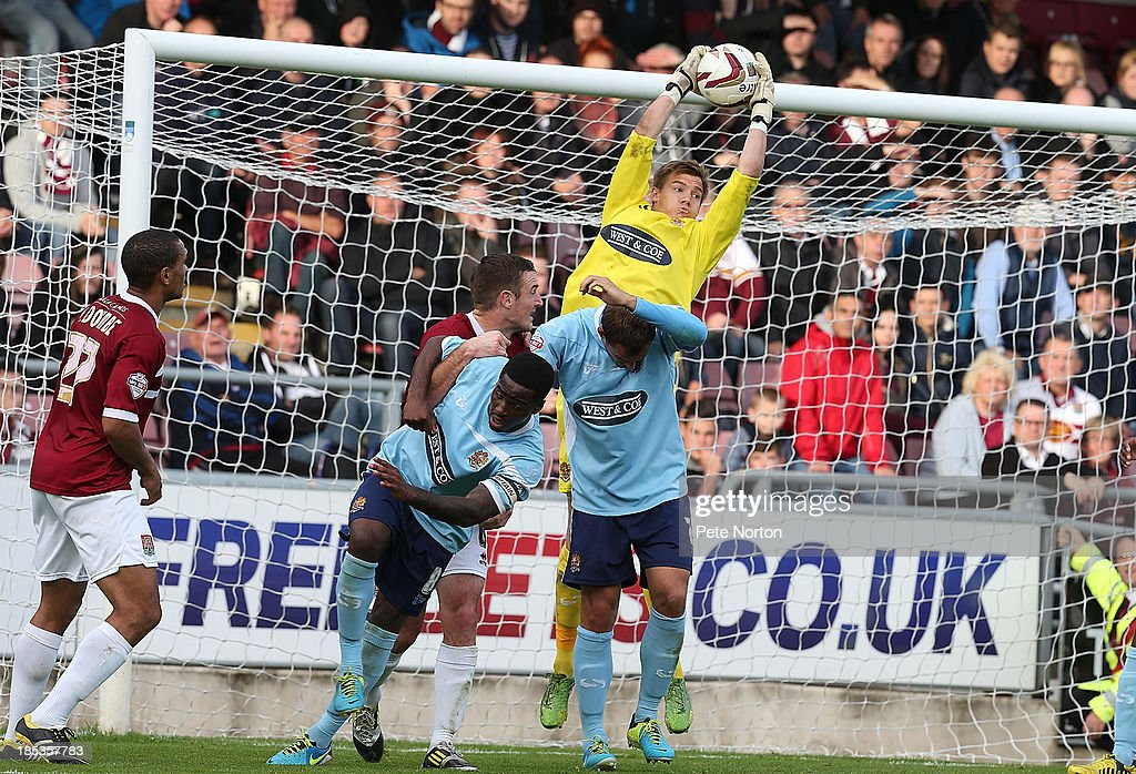 Chris Lewington of Dagenham & Redbridge collects the ball under pressure during the Sky Bet League Two match between Northampton Town and Dagenham & Redbridge at Sixfields Stadium on October 19, 2013 in Northampton, England.