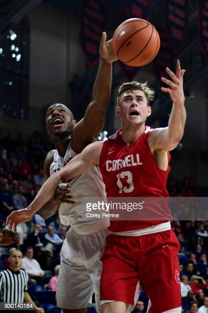 Chris Lewis of the Harvard Crimson and Stone Gettings of the Cornell Big Red vie for the ball during the first half of a semifinal round matchup in...