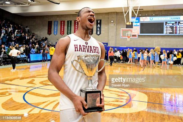 Chris Lewis of the Harvard Crimson celebrates his teams 83-81 win in overtime over the Columbia Lions to win the regular season IVY League title 1at...