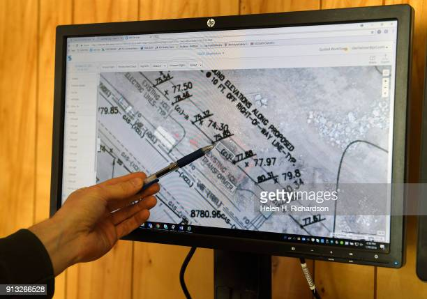 Chris Lierheimer shows on his computer how the photos he took with his unmanned aerial vehicle of UAE can be matched up with construction site...