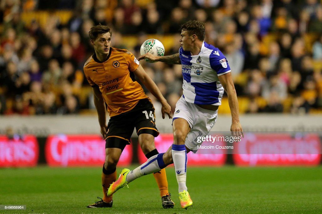 Chris Lines of Bristol Rovers competes with Michal Zyro of Wolverhampton Wanderers during the Carabao Cup tie between Wolverhampton Wanderers and Bristol Rovers at Molineux on September 19, 2017 in Wolverhampton, England.