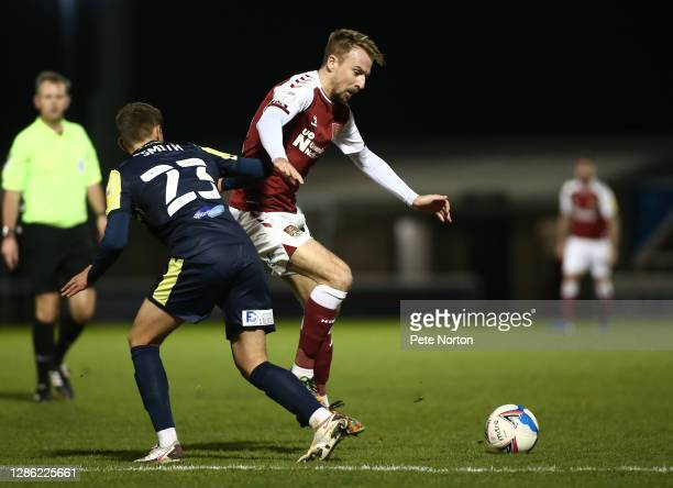 Chris Lines of Northampton Town moves with the ball past Jack Smith of Stevenage during the Papa John's Trophy match between Northampton Town and...