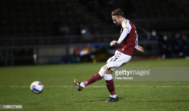 Chris Lines of Northampton Town takes his penalty during a penalty shoot out during the Papa John's Trophy match between Northampton Town and...