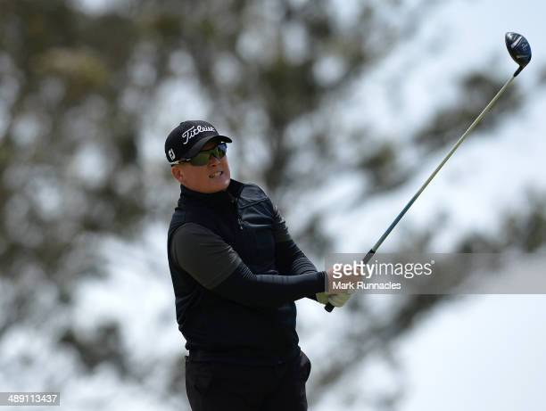 Chris Lloyd of England plays his tee shot at the 16th during the Madeira Islands Open - Portugal - BPI at Club de Golf do Santo da Serra on May 10,...