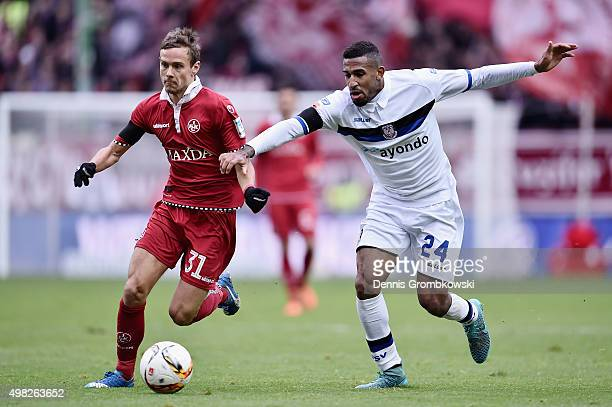Chris Loewe of 1 FC Kaiserslautern and Shawn Maurice Barry of FSV Frankfurt battle for the ball during the Second Bundesliga match between 1 FC...