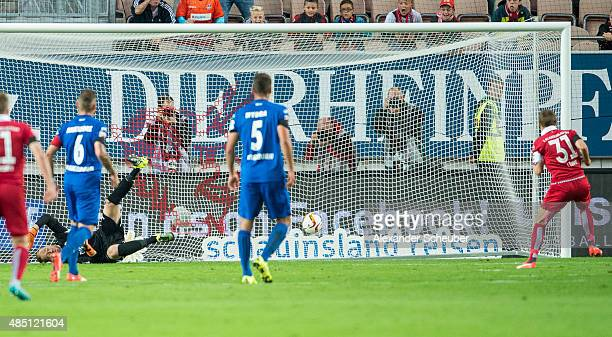 Chris Loewe of 1 FC Kaiserslautern scores his team's first goal against goal keeper Lukas Kruse of SC Paderborn during the second Bundesliga match...
