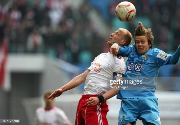 Chris Loewe of Chemnitz jumps for a header with Tim Sebastian of Leipzig during the Regionalliga match between RB Leipzig and Chemnitzer FC at the...