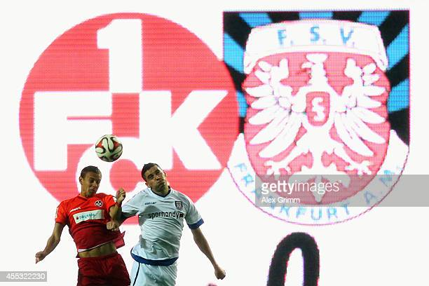 Chris Loewe of Kaiserslautern jumps for a header with Odise Roshi of Frankfurt during the Second Bundesliga match between 1 FC Kaiserslautern and FSV...