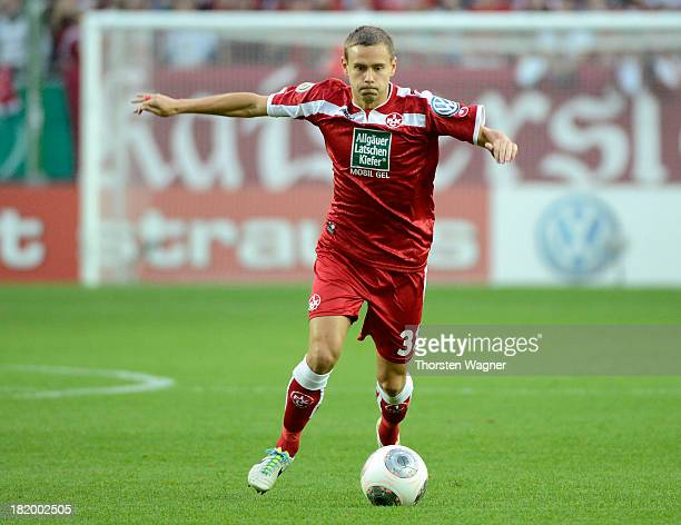 Chris Loewe of Kaiserslautern runs with the ball during the DFB Cup 2nd round match between 1FC Kaiserslautern and Hertha BSC Berlin at...