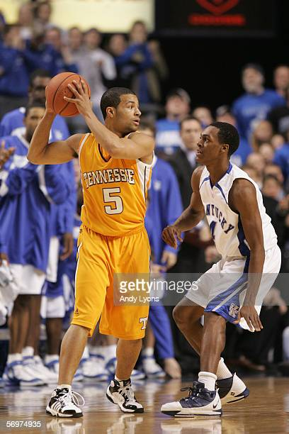 Chris Lofton of the Tennessee Volunteers holds the ball against Rajon Rondo of the Kentucky Wildcats at Rupp Arena on February 7, 2006 in Lexington,...