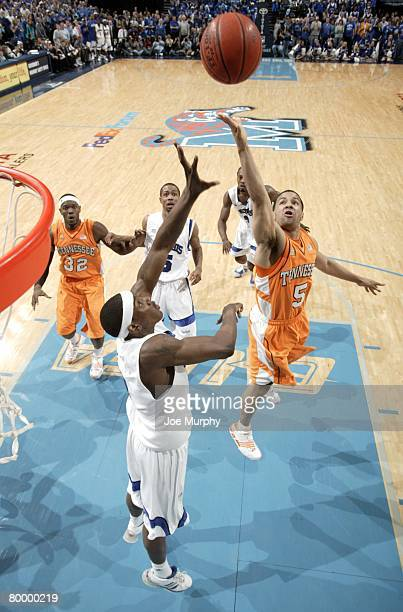 Chris Lofton of the Tennessee Volunteers shoots over Robert Dozier of the Memphis Tigers at FedExForum on February 23, 2008 in Memphis, Tennessee....