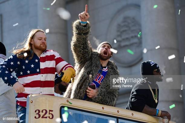 Chris Long lets out a yell on a parade vehicle next to Beau Allen of the Philadelphia Eagles during festivities on February 8 2018 in Philadelphia...