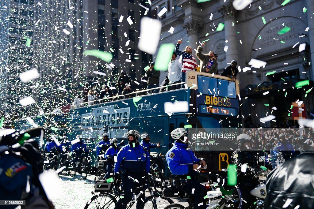 Chris Long #56 (C) lets out a yell on a parade vehicle next to Beau Allen (L) of the Philadelphia Eagles during festivities on February 8, 2018 in Philadelphia, Pennsylvania. The city celebrated the Philadelphia Eagles' Super Bowl LII championship with a victory parade.