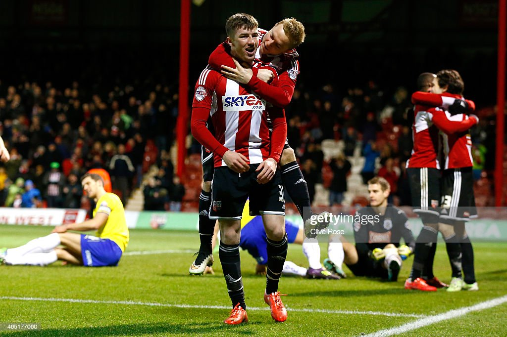 Chris Long of Brentford celebrates his second goal during the Sky Bet Championship match between Brentford and Huddersfield Town at Griffin Park on March 3, 2015 in Brentford, England.