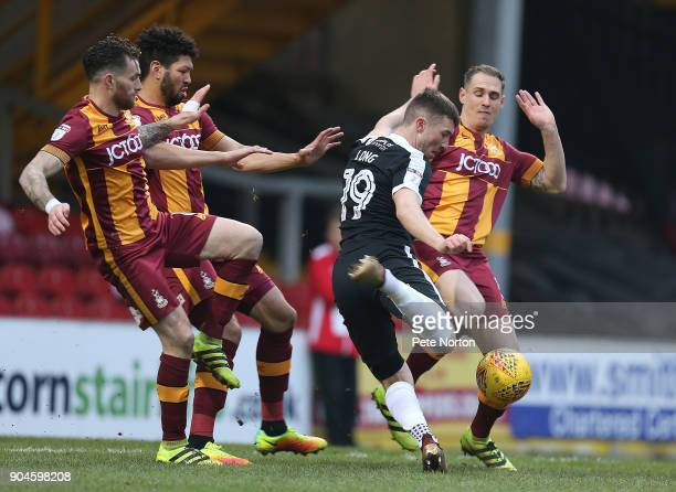 Chris Long of Northampton Town attempts to get a shot at goal away under pressure from Romain Vincelot Nathaniel KightPercivall and Matthew Kilgallon...