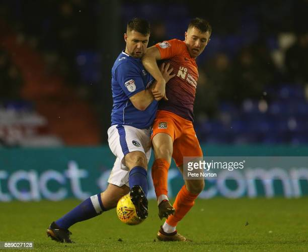 Chris Long of Northampton Town contests the ball with Anthony Gerrard of Oldham Athletic during the Sky Bet League One match between Oldham Athletic...