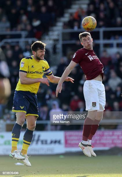 Chris Long of Northampton Town contests the ball with John Mousinho of Oxford United during the Sky Bet League One match between Northampton Town and...