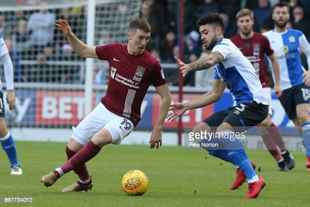 Chris Long of Northampton Town controls the ball watched by Derrick Williams of Blackburn Rovers during the Sky Bet League One match between...