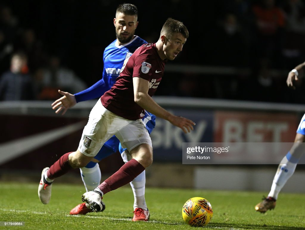 Chris Long of Northampton Town moves with the ball past Max Ehmer of Gillingham during the Sky Bet League One match between Northampton Town and Gillingham at Sixfields on February 13, 2018 in Northampton, England.