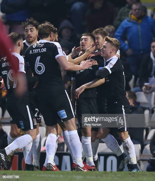 Chris Long of Northamptpn Town is congratulated by team mates after scoring his sdes second goal during the Sky Bet League One match between Bradford...