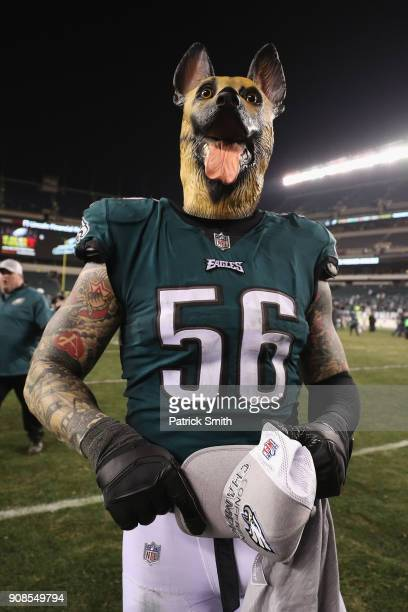 Chris Long of the Philadelphia Eagles celebrates his teams win while wearing a dog mask over the Minnesota Vikings in the NFC Championship game at...
