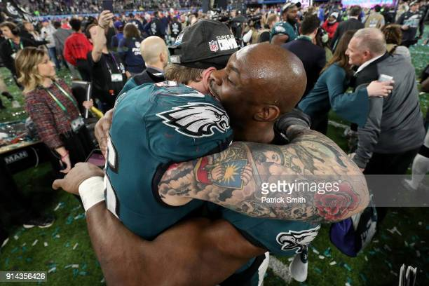 Chris Long of the Philadelphia Eagles celebrates with Corey Graham after defeating the New England Patriots 4133 in Super Bowl LII at US Bank Stadium...