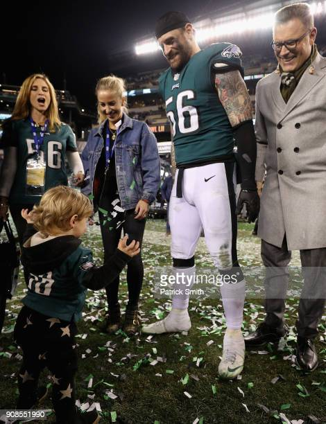 Chris Long of the Philadelphia Eagles celebrates with his son Waylon James Long and his father and former NFL player Howie Long after defeating the...