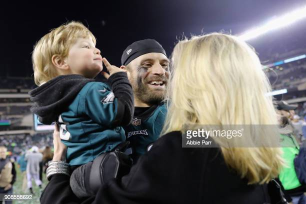 Chris Long of the Philadelphia Eagles celebrates with his son Waylon James Long after defeating the Minnesota Vikings in the NFC Championship game at...