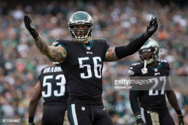 Chris Long of the Philadelphia Eagles reacts along with Nigel Bradham and Malcolm Jenkins against the Denver Broncos at Lincoln Financial Field on...