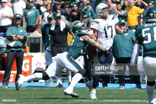 Chris Long of the Philadelphia Eagles sacks Philip Rivers of the Los Angeles Chargers during the first half of the NFL game at StubHub Center on...