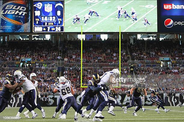 Chris Long of the St Louis Rams sacks Philip Rivers of the San Diego Chargers at the Edward Jones Dome on October 17 2010 in St Louis Missouri The...