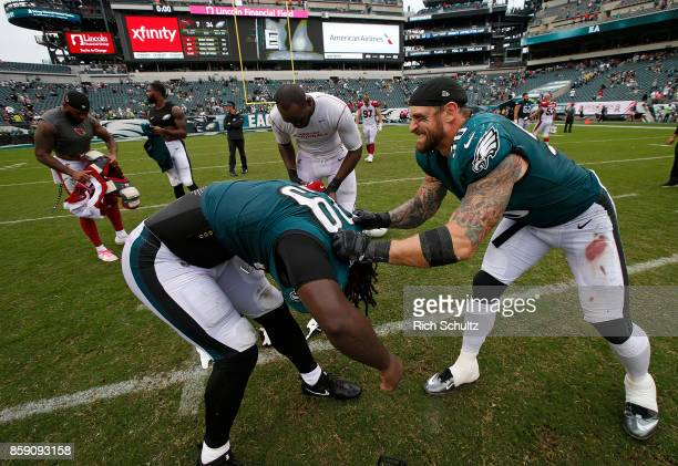 Chris Long right of the Philadelphia Eagles helps LeGarrette Blount off with his jersey that he will exchange with his former Patriots teammate...