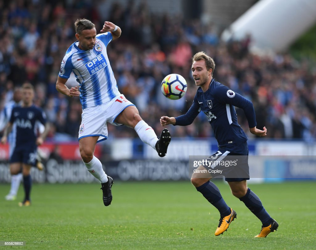 Chris Lowe of Huddersfield Town and Christian Eriksen of Tottenham Hotspur battle for possession during the Premier League match between Huddersfield Town and Tottenham Hotspur at John Smith's Stadium on September 30, 2017 in Huddersfield, England.