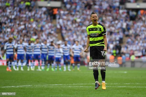 Chris Lowe of Huddersfield Town celebrates scoring his sides first penalty in the penalty shoot out after the Sky Bet Championship play off final...