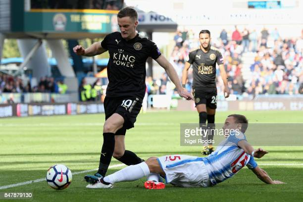 Chris Lowe of Huddersfield Town fouls Andy King of Leicester City and a penalty is awarded to Leicester City during the Premier League match between...