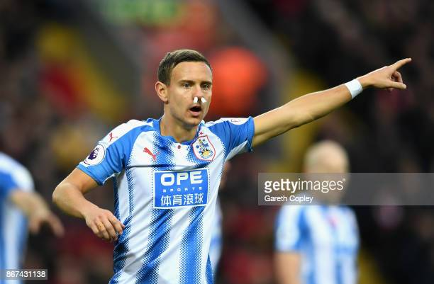 Chris Lowe of Huddersfield Town gives his team instructions during the Premier League match between Liverpool and Huddersfield Town at Anfield on...