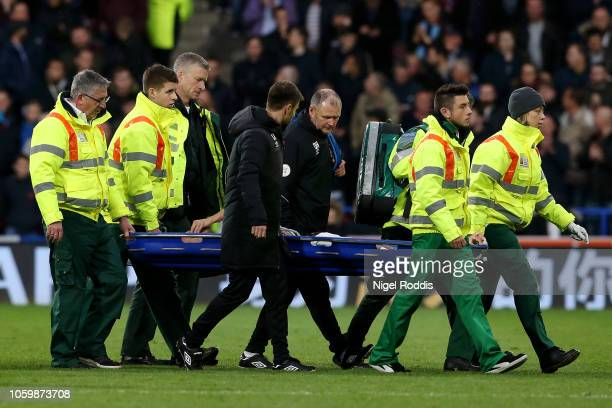 Chris Lowe of Huddersfield Town is carried off the pitch on a stretcher during the Premier League match between Huddersfield Town and West Ham United...