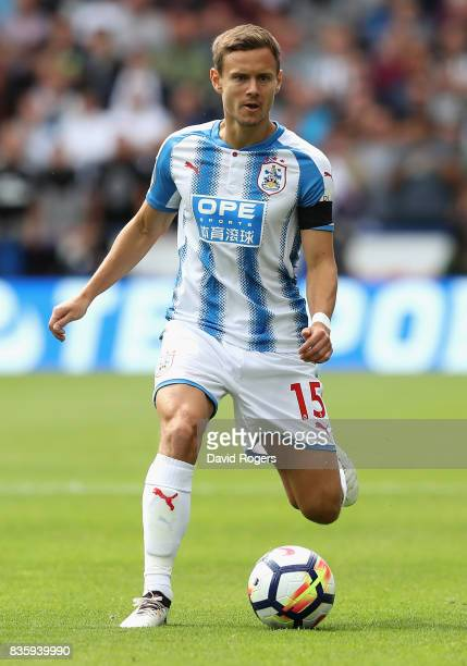 Chris Lowe of Huddersfield Town runs with the ball during the Premier League match between Huddersfield Town and Newcastle United at John Smith's...
