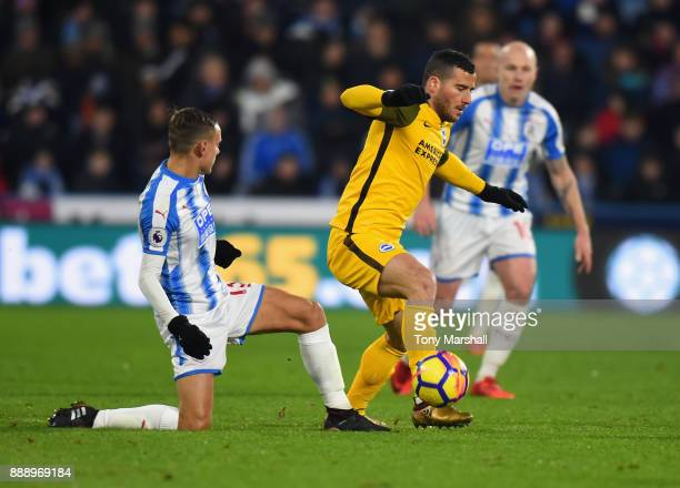 Chris Lowe of Huddersfield Town tackles Tomer Hemed of Brighton and Hove Albion during the Premier League match between Huddersfield Town and...