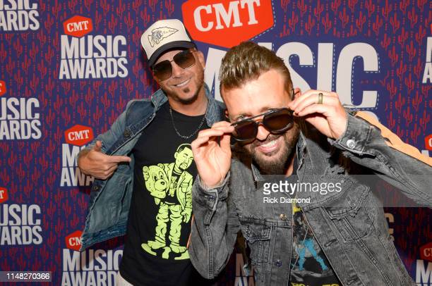 Chris Lucas and Preston Brust of LOCASH attend the 2019 CMT Music Awards at Bridgestone Arena on June 05 2019 in Nashville Tennessee