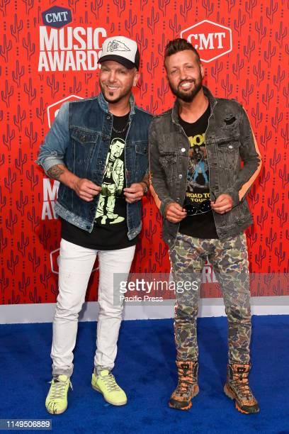 Chris Lucas and Preston Brust of LoCash attends the 2019 CMT Music Awards at the Bridgestone Arena in Nashville Tennessee