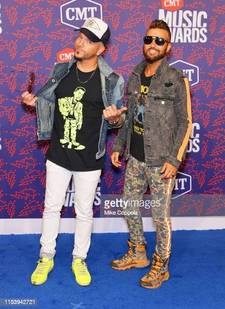 Chris Lucas and Preston Brust of LOCASH attends the 2019 CMT Music Award at Bridgestone Arena on June 05 2019 in Nashville Tennessee