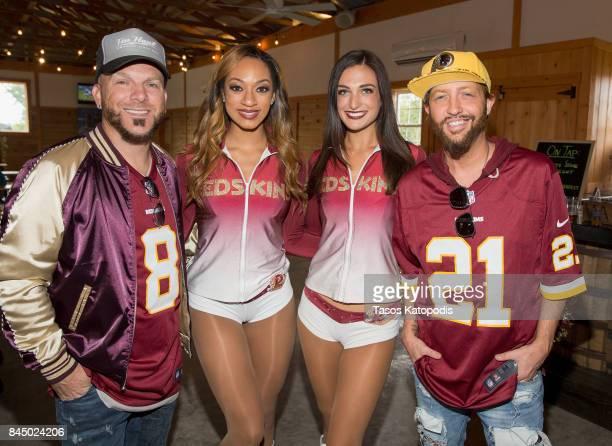 Chris Lucas and Preston Brust of LOCASH pose with Washington Redskins cheerleaders at Vanish Brewery on September 9 2017 in Leesburg Virginia