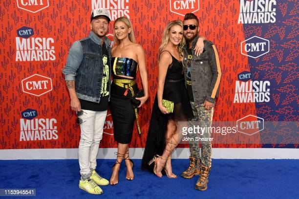 Chris Lucas and Preston Brust of LOCASH with Kaitlyn Lucas and Kristen Brust attends the 2019 CMT Music Award at Bridgestone Arena on June 05 2019 in...